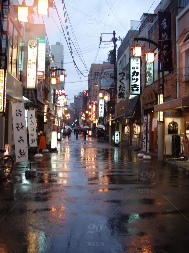Japanese Street Fashion Trends: Rainy Evening In Japanese Street; Neon Signs Reflect In