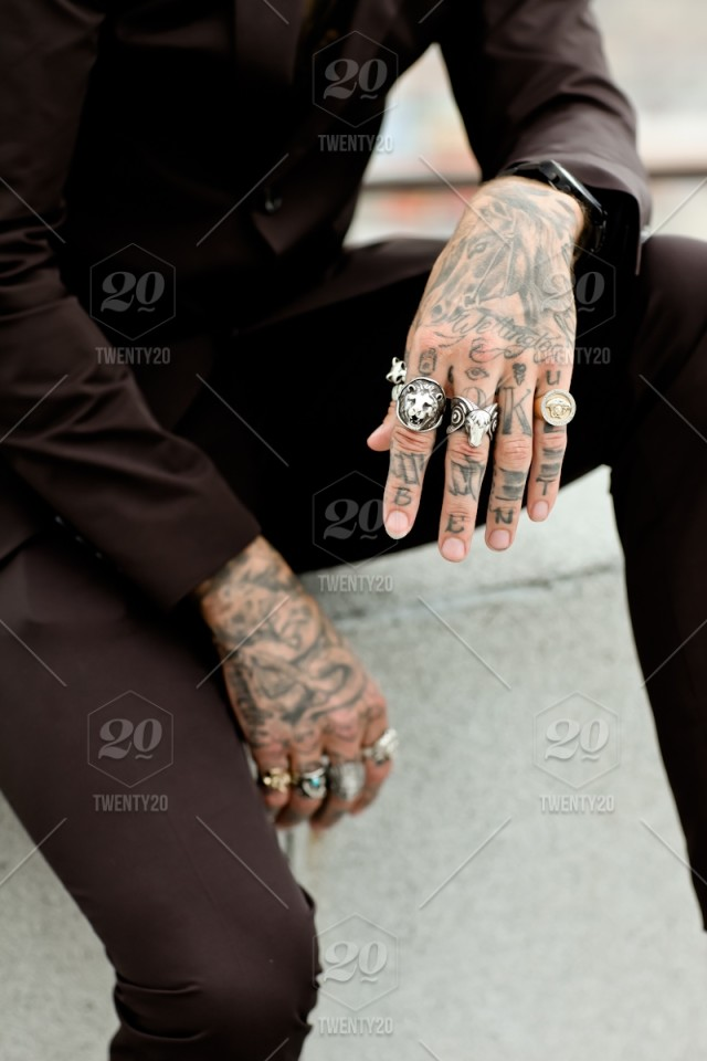 84756931b Close up of male model's tattooed hands and rings. stock photo ...