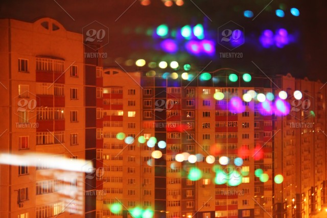 Colorful Christmas Lights On House.The View From A Window On The Houses With Colorful Lights In