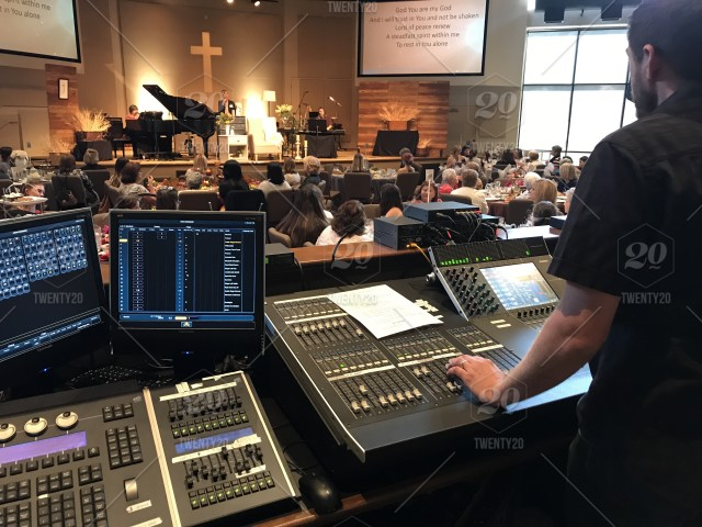 Sound mixer controlling levels at a women's church event