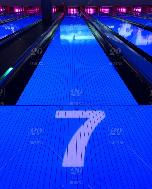 Vivid colors light up the bowling alley on cosmic night  stock photo