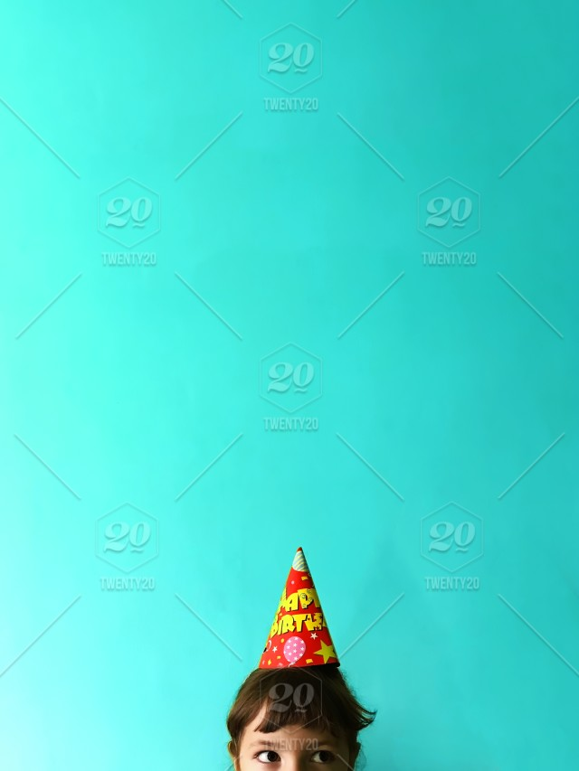 happy birthday party cap on blue background with a copy space