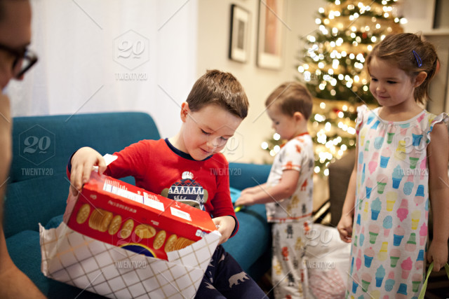 001235e67d7b Young boy opening gift on Christmas morning stock photo 5e16f7f8 ...