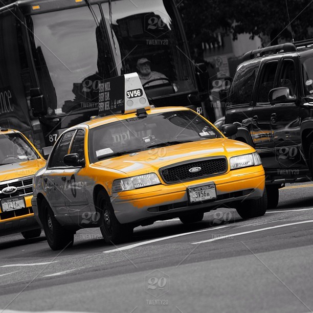 Yellow taxi cab in New York City, with a yellow filter applied stock