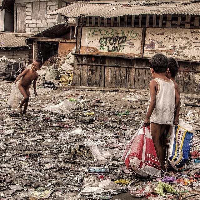 Children living and working in the, literally, garbage hill ...
