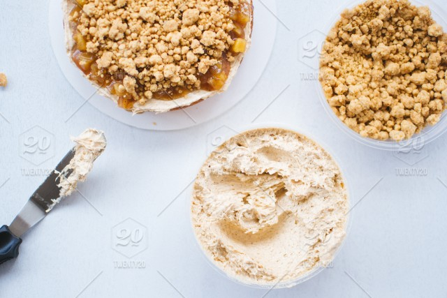Apple Pie Cake Ingredients With Crumbs And Frosting Stock Photo