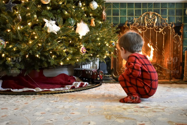 Toddler Boy Christmas Pajamas.Cute Toddler Boy In Red Flannel Pajamas Squatting To Watch