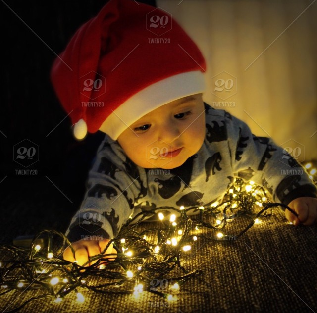 222facdcf5bbb Baby boy with Santa hat and Christmas lights ❗ ❗ ✨NOMINATED✨❗ ❗ stock photo  178662b0-a2d7-4c77-b05a-4dde7f34df28