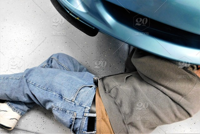 Do it yourself auto repairs a man is under his car to replace the do it yourself auto repairs a man is under his car to replace the radiator solutioingenieria Choice Image