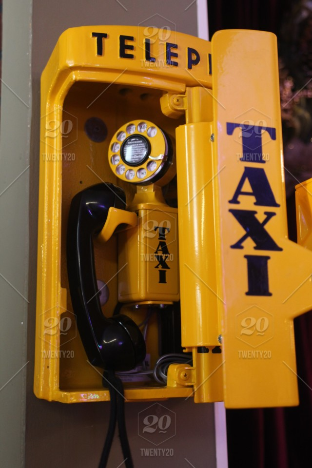 VINTAGE YELLOW TAXI WALL PHONE stock photo