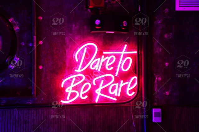 dare to be rare colorful pink neon light typography quotes stock
