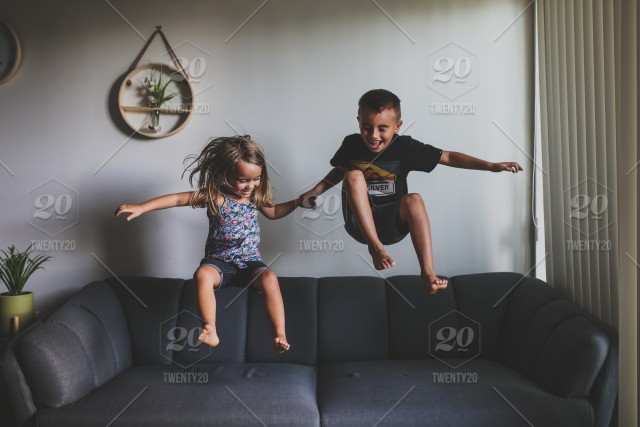 Kids Jumping On The Couch Stock Photo A270719a 9286 41df 9080