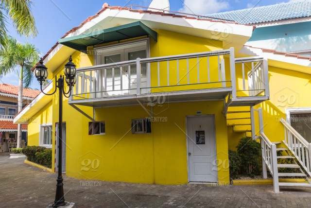 Yellow house in Punta Cana  Dominican Republic stock photo