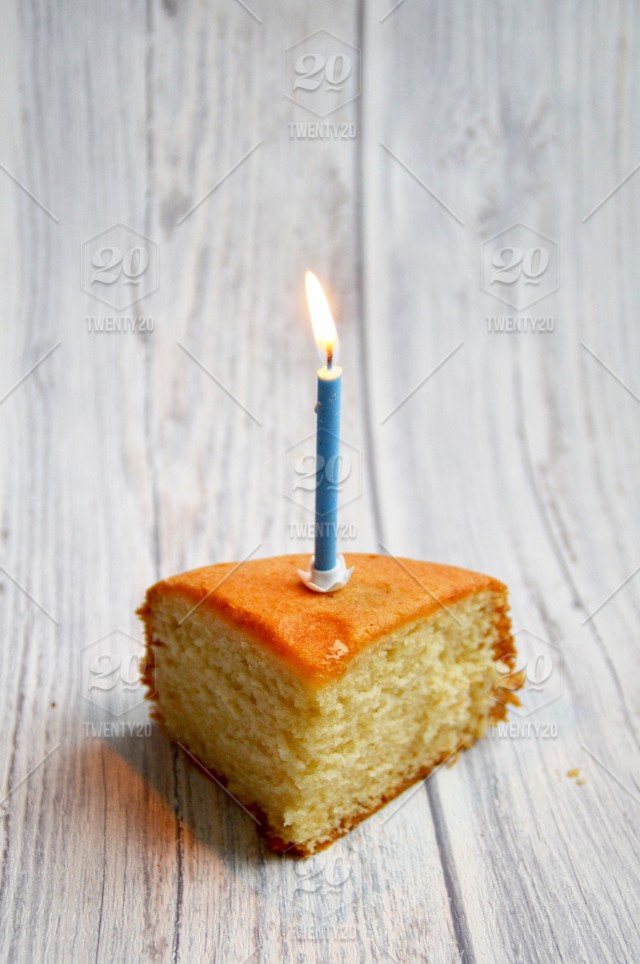 Piece Of Cake With Candle Stock Photo F0c84a1b 7bda 42f0 A19f