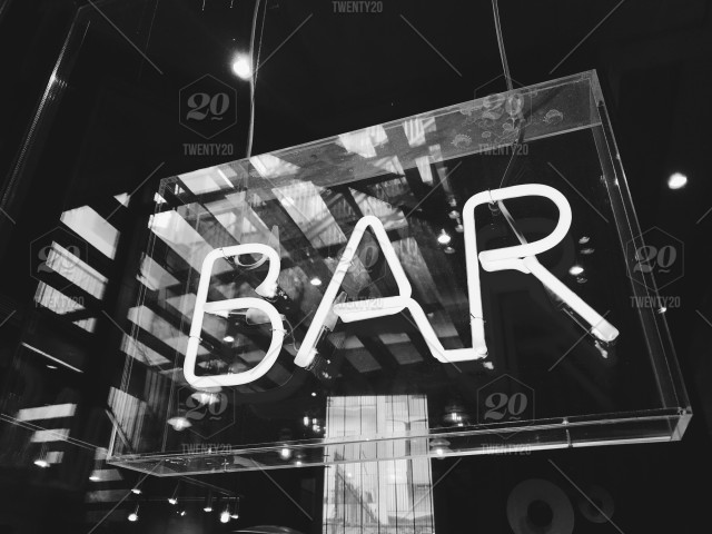 Neon sign 'bar' in Barcelona Spain - black and white edit stock