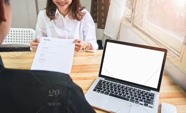 Young Woman Submit Resume To Employer To Review Job