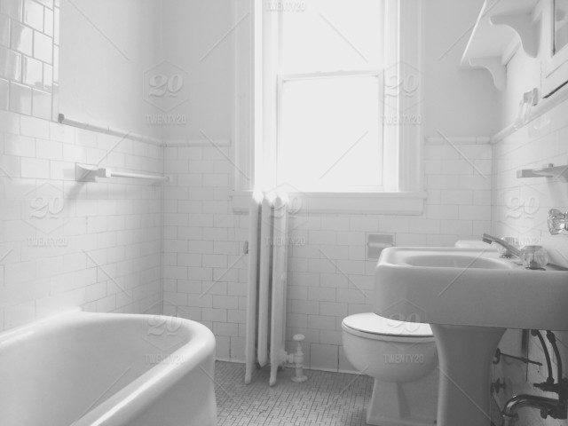 Desaturated Black And White Photo Of A Clean Bathroom With White
