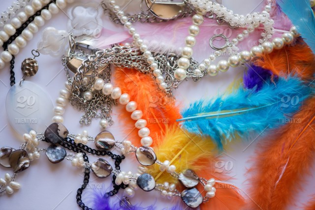 pearls and multicolored feathers romantic set up with empty spacebackgroundbeautifulbeauty carefashionpearlingchristmasdecorationconceptscopy