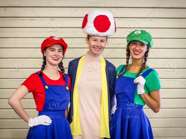 Three Cosplay Girls Dressed As The Supermario Brothers Mario