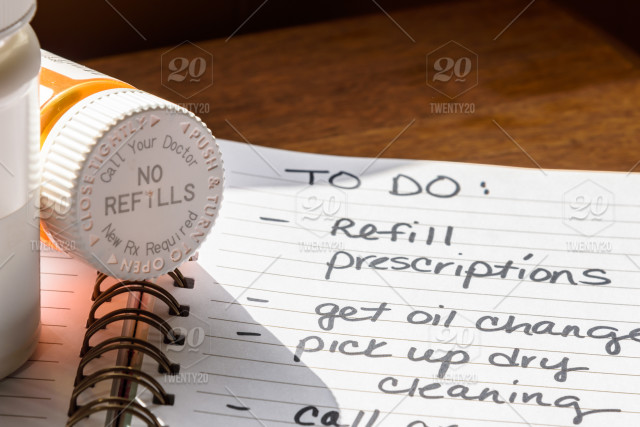 Pill bottle with no refills and hand written to do list with