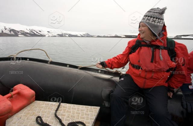 An adventure tourist on a zodiac inflatable boat in Antarctica