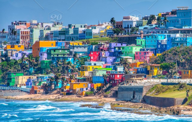 colorful houses line the hillside over looking the ocean on the island
