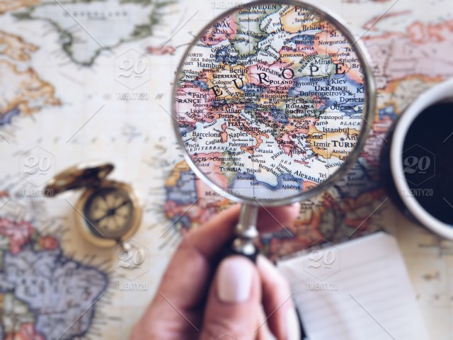 Map Of The World With Compass.Map Of The World With A Compass Magnifying Glass Zooming On