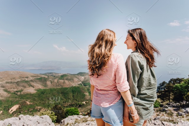 Two girls smile at the top of mountain. stock photo 22fd41b1-697e ... 36dd50e4ead0e
