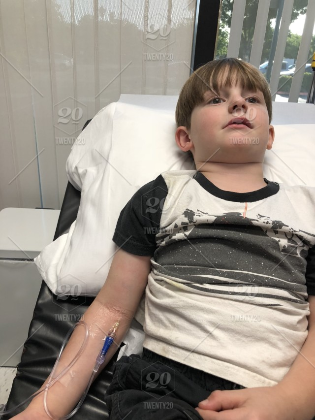 Little Boy With Iv For Ear Infection Antibiotics Doctors Office