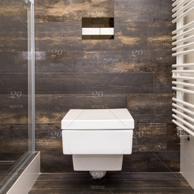 A new white toilet, built into the wall in the bathroom, modern ...