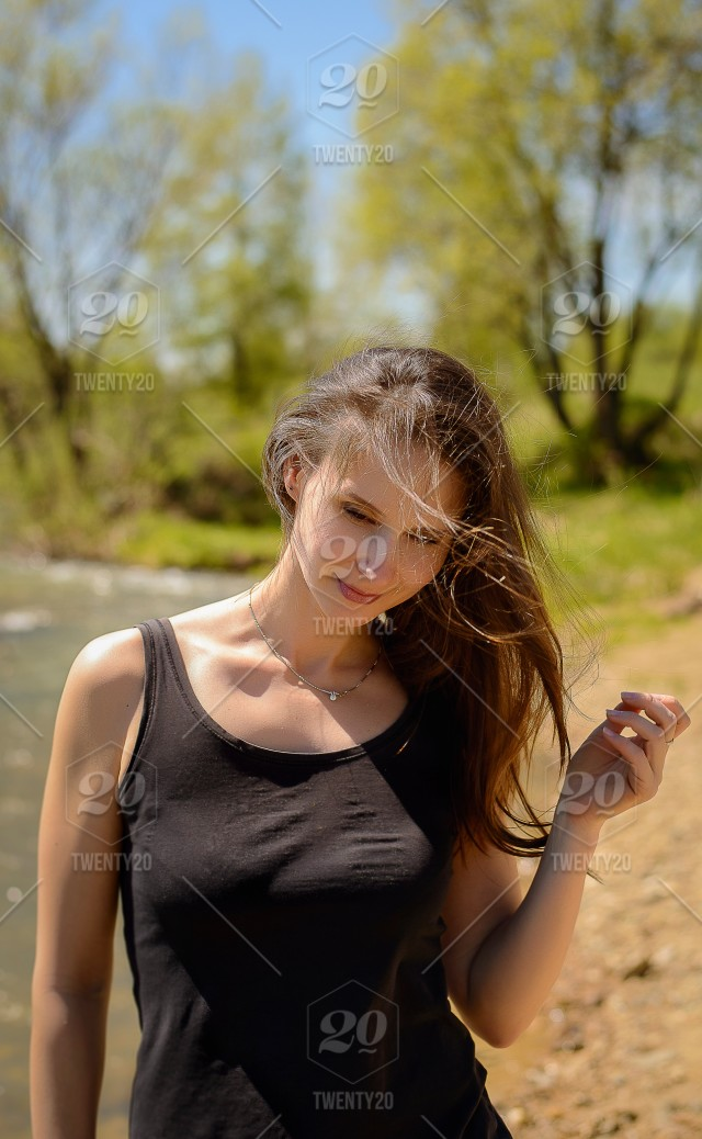 Female Portrait Face Of A Woman With Disheveled Hair Wind Inflates Womans Young Walking Along The River Long