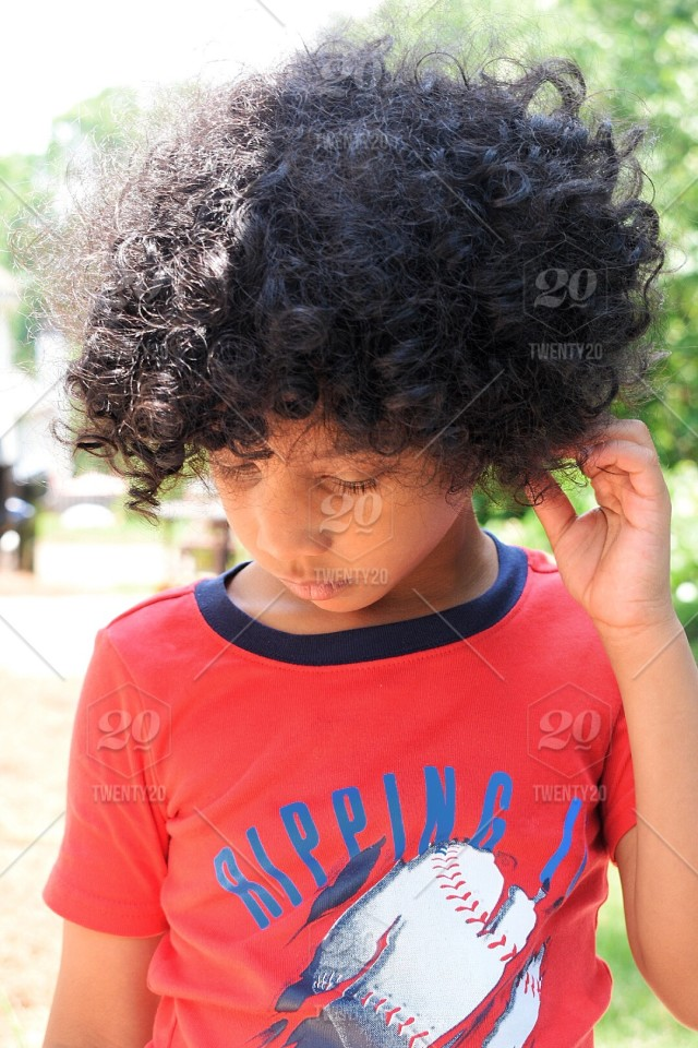 Outdoors Red Kid Baseball Curls Curly Hair Sunny Morning Thinking Boy Stock Photo Ef077975 D7b7 4d1e 9bf4 D2ae07467876
