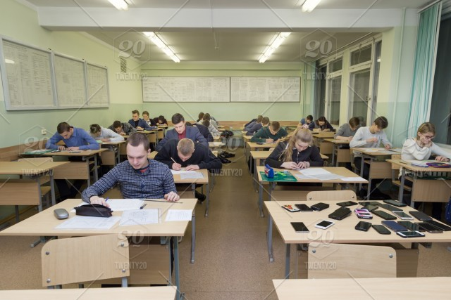 Students At The Desks In The Universitys Classroom Do Exam Work