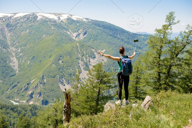 Woman With Selfie Stick In The Mountains Enjoy Mobile Use Photography Nature Travel Travelergirl Cliff Young View Edge Sky