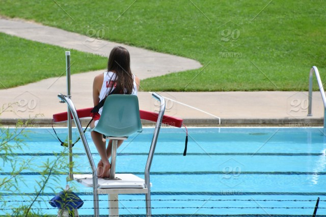 Female Lifeguard On Duty At A Public Swimming Pool
