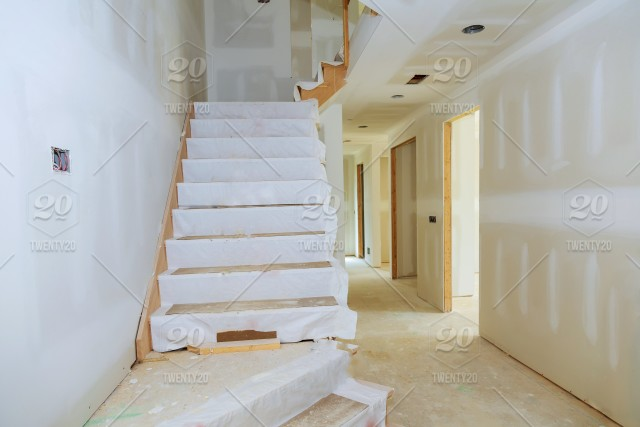 Unfinished room of inside house under construction drywall ...