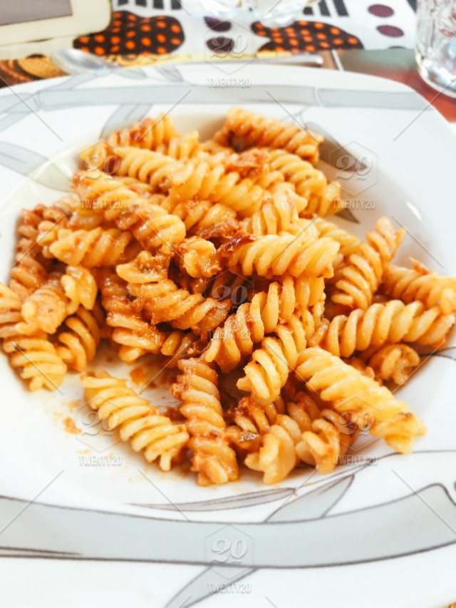High Angle View Of Noodles In Plate On Table Stock Photo