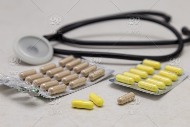 Pills And Phonendoscope Are On The Table Health Medication