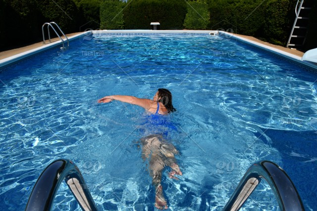 Nominated** A female swimming laps for exercise in an outdoor pool ...