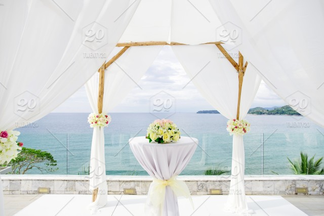 Wedding Arch And Altar For Traditional Wedding Ceremony Decoration With White Soft Fabric And Flower Bouquet The Wedding Venue Outdoor With Panoramic Sea View In Background Stock Photo 2f8e16c3 C306 44e3 B699 39dfbf5ef72f