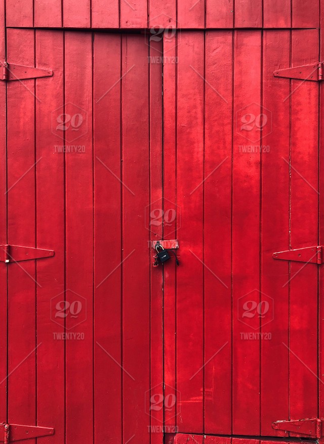 Painted red old barn door with a lock stock photo 87bffb81