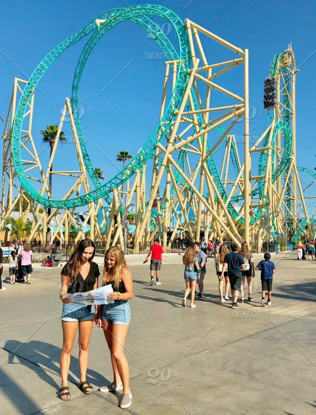 Two millennial girls looking at an amut park map while at ... on usc map, knott's map, kings island map, amtrak map, six flags map, buena park map, chino hills state park map, cedar point map, disneyland map, dollywood map, disney map, hersheypark map, universal studios map, dorney park map, great america map, santa monica map, los angeles map, san diego map, university of southern california map, sesame place map,