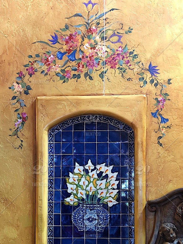 Beautiful ceramic tiles and painted mural decorate a local Mexican