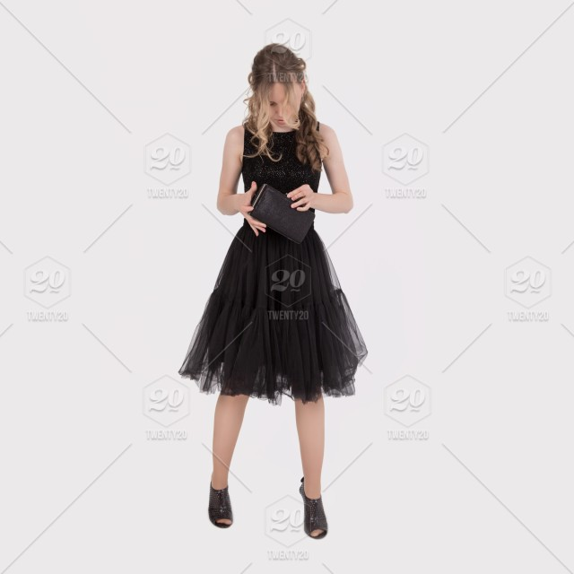 9681b37d352 A girl in an elegant black dress is looking for personal items in a ...