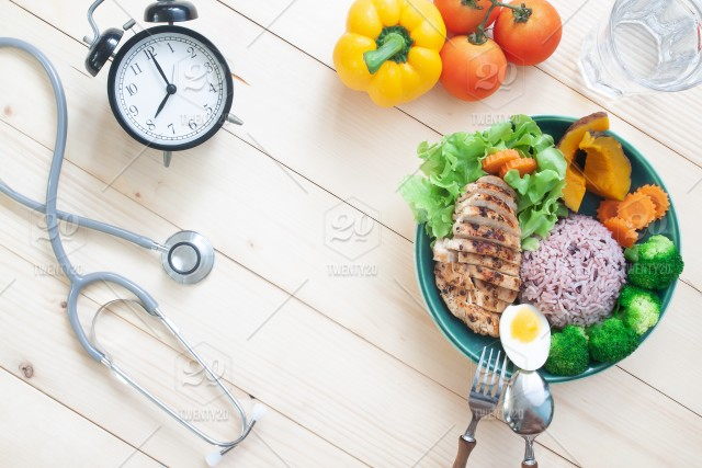 Stethoscope And Healthy Food With Chicken Breast And Vegetables