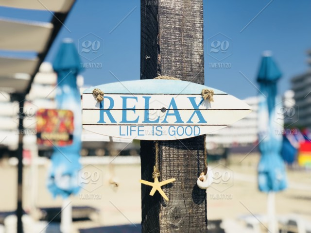 Relax Wooden Sign On The Beach Stock Photo 00beaba7 9477 479a