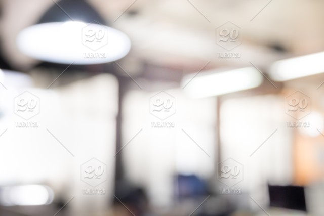 Blurred Abstract Image Of Modern Office With Electronic Lamp And
