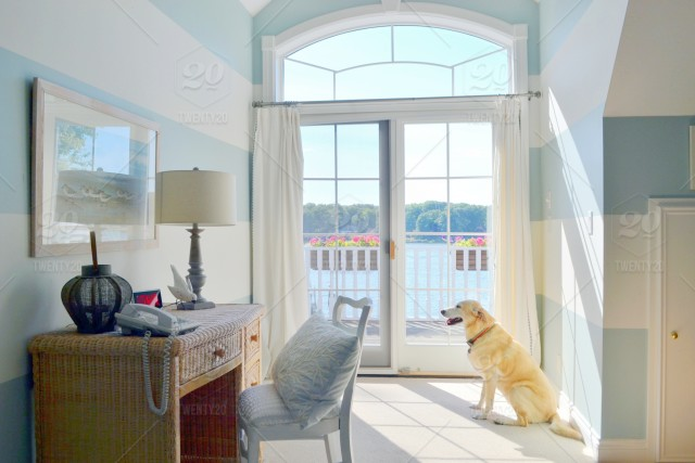 Beautiful bedroom with blue painted walls, sliding window ...