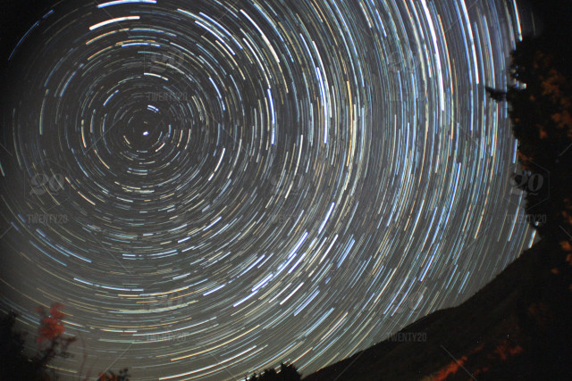 Spinning underneath the stars. stock photo 9c47a0e9-e96c-40ab ...