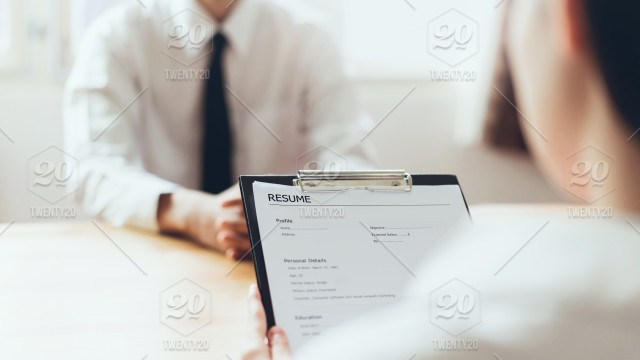 Man Submit Resume To Employer To Review Job Application The